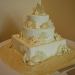 14 wedding white chocolate shells sand on table square bottom