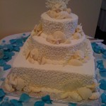 11 wedding coral white chocolate shells blue petals on table
