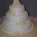 13 wedding champagne rounded edges shells sand on table